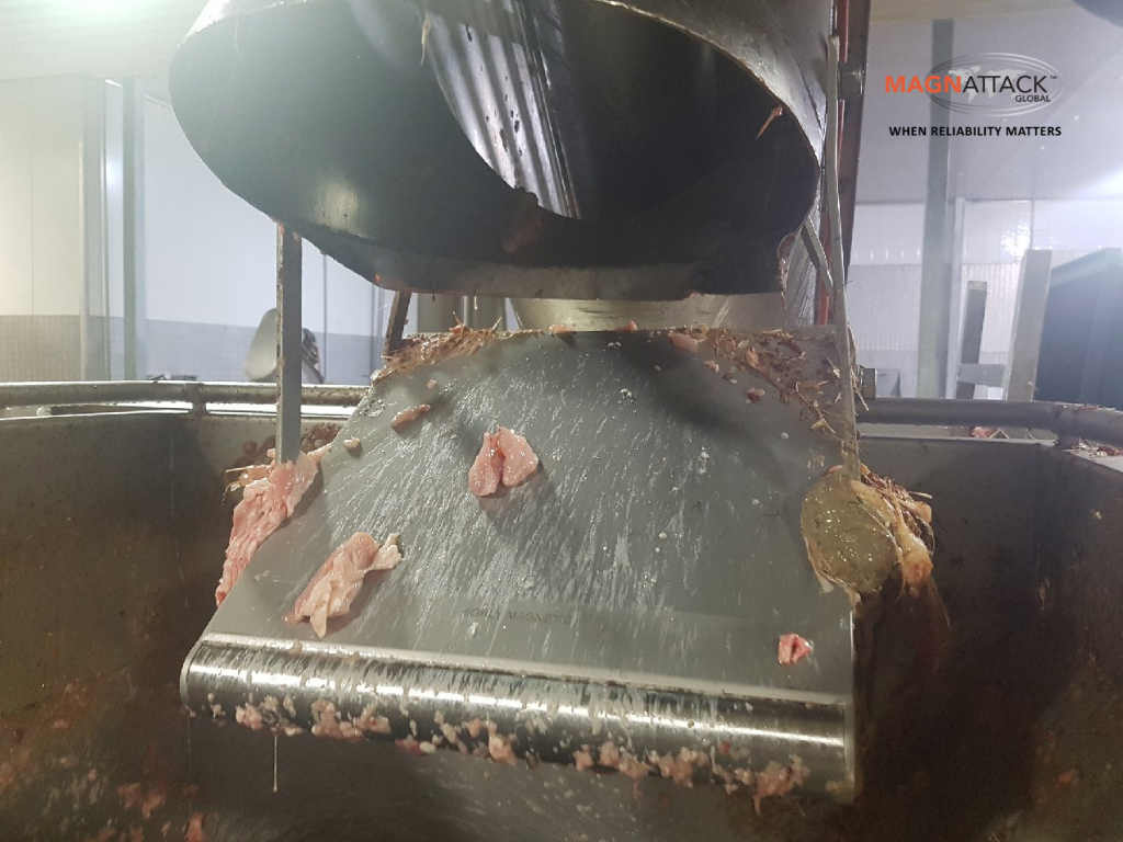 Image of a high-intensity RE80 Round Nose Plate Magnet installed in a meat line.